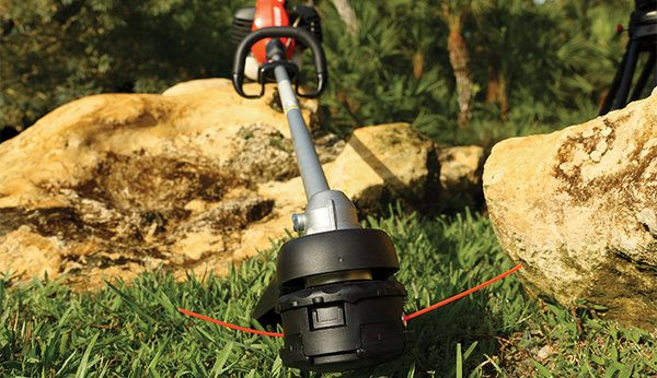 ECHO trimmer leaning on rocks